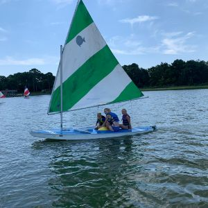 3-campers-sailing-the-green-and-white-boat-2.jpg