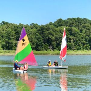 rainbow and red sunfish boats