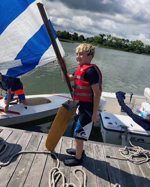 Picture of boy getting ready to sail