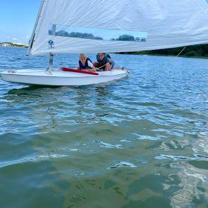 campers-peek-under-their-sail.jpg