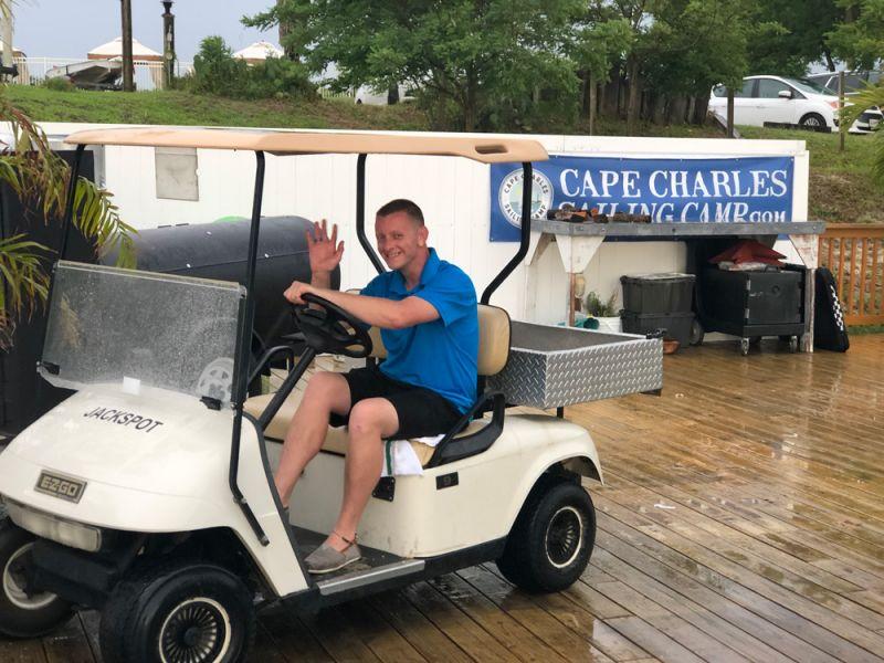 Jason driving a golfcart