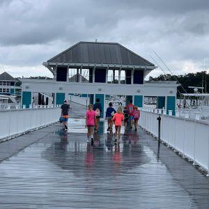 campers-walking-down-the-dock-in-the-rain.jpg