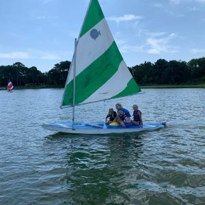 3-campers-sailing-the-green-and-white-boat.jpg