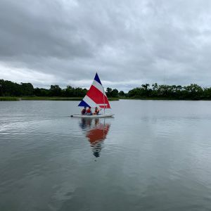 3-campers-in-the-red-white-and-blue-boat.jpg
